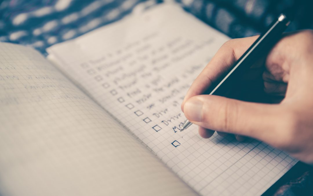 person writing top sales tips list in notebook